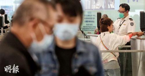 香港机场持续爆发麻疹,不少在机场工作的人员及旅客都戴上口罩。图片来源:香港《明报》/李绍昌 摄