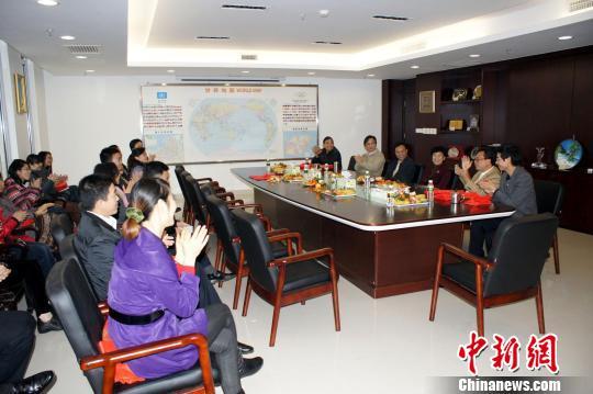 海口市副市长韩美赴市外侨办走访拜年(图)